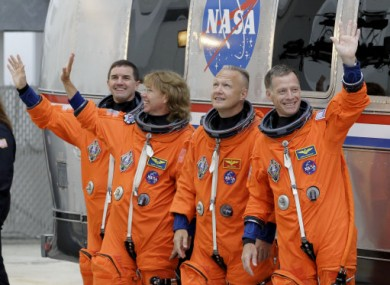 Mission specialists Rex Walheim, Sandy Magnus, pilot Doug Hurley and commander Chris Ferguson on their way to the space shuttle Atlantis