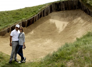 Spanish golfer Pablo Larrazabal poses with his girlfriend Gala by the famous bunker on Royal St George's fourth hole.