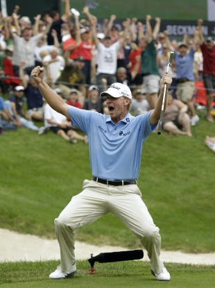 Stricker reacts after holing out on the 18th to win.