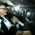 Rupert Murdoch relaxes in his car as the phone hacking scandal rolls on (Steve Parsons/PA Wire)
