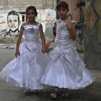 Palestinian girls in wedding dresses at Shati Refugee Camp in Gaza City (AP Photo /Adel Hana)