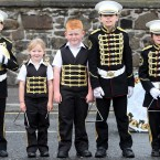Young band members wait to join a Twelfth of July march by Orangemen in Belfast (Paul Faith/PA Wire)