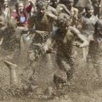 Children during the annual Mud Day in Westland, Michigan (AP Photo/Carlos Osorio)