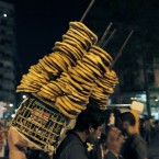 An Egyptian bread vendor among protesters at Tahrir Square in Cairo, Egypt (AP Photo/Nasser Nasser)