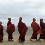 A group of young Buddhist monks parade seeking alms in Colombo, Sri Lanka (AP Photo/ Eranga Jayawardena)