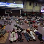 Passengers sleep on a platform at the railway station in Bhubaneswar, India (AP Photo/Biswaranjan Rout)