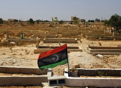 The flag of the Libyan opposition at the grave of a rebel killed in recent fighting.