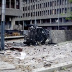 The wreckage of a car lies outside government buildings in the centre of Oslo on July 22, 2011, following an explosion that tore open several buildings including the prime minister's office. (AP Photo/Fartein Rudjord)