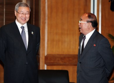 North Korea's foreign minister Pak Ui Chun, right, speaks with his South Korean counterpart Kim Sung-hwan at an ASEAN conference on Saturday.