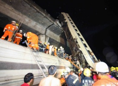 Rescuer workers at the scene of the Wenzhou rail crash.