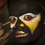 An Indian artist gets made up during a Bonalu festival in Hyderabad. (AP Photo/Mahesh Kumar A)