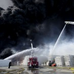 Smoke pours from a fire at the huge Macro Plastics plant in Fairfield, California. (AP Photo/Rich Pedroncelli)