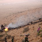 Rescuers at the site of a plane crash near Guelmim, southern Morocco. Some 78 people were killed. (AP Photo)