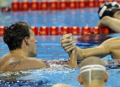 Lochte is congratulated by a disappointed Phelps