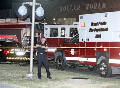 Police seal off the scene of last night's shooting at the Roller World rink in Grand Prairie, Texas.