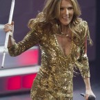 Er, where you going with that stick Celine?... Performing during her opening night at Caesar's Palace in Las Vegas, 15 March 2011. Pic: Julie Jacobson/AP/Press Association Images