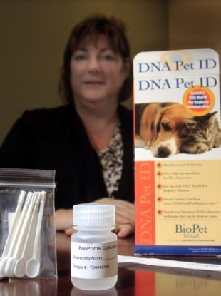 Debbie Violette, an apartment complex manager in New Hampshire, with a DNA test kit for pets.