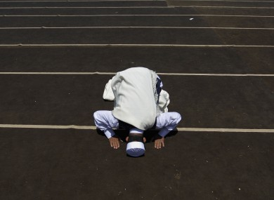 A Libyan man prays during Friday prayers in the rebel-held Benghazi, Libya today