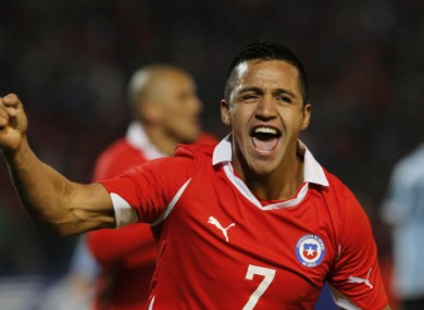 Sanchez celebrates his equaliser against Uruguay.