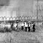 A year on - on August 13, 1962 West Berlin youth protestors carry a black cross with the slogan