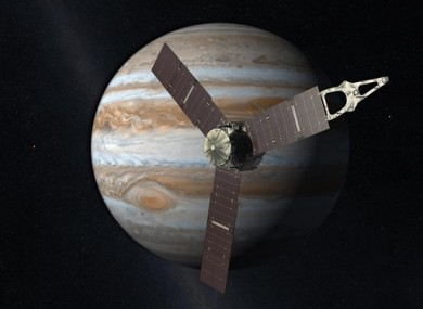 An artist's depiction of the NASA Juno spacecraft in front of Jupiter.