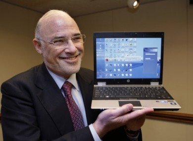 HP CEO Leo Apotheker holding one of HP's Elitebooks in March 2011.