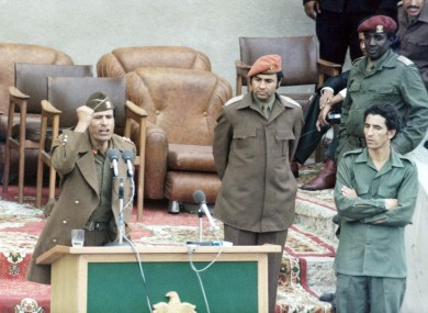 Then-prime minister Abdessalam Jalloud, pictured far right, watches Muammar Gaddafi (left) give a speech in 1977. Jalloud has now joined the side of the Libyan rebels trying to oust Gaddafi.