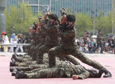 File photos of South Korean soldiers during a martial arts demonstration in May 2011.