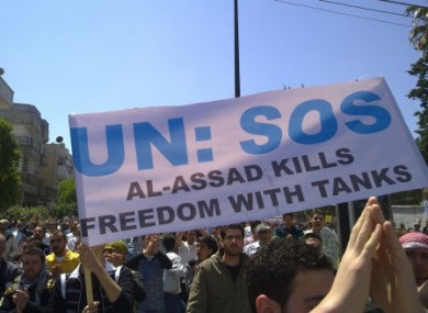 File photo of a protest poster appealing for UN intervention in the Syrian city of Homs.