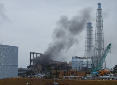 Smoke rises from Fukushima reactor 3 in this March 21 photo