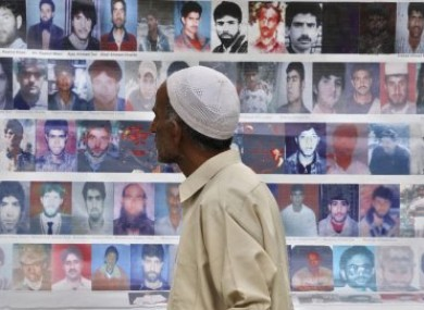 A man walks past photos of missing people during a demonstration organised by the Association of Parents of Disappeared Persons last month.