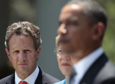 Treasury Secretary Timothy Geithner listening to Barack Obama speak on 18 July, 2011.