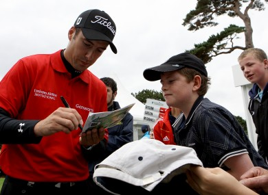 Fisher signing an autograph for a young fan at last month's Irish Open.
