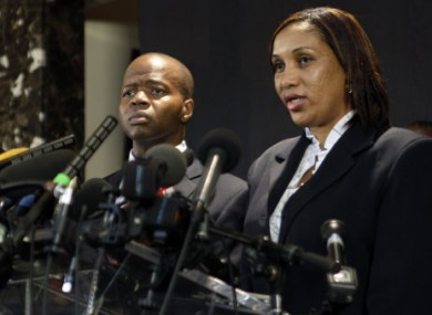 Nafissatou Diallo, right, who accused former IMF Head Dominique Strauss-Kahn of sexually attacking her, speaks to reporters