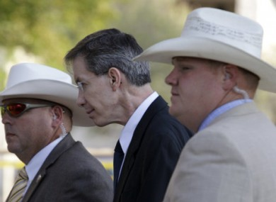 Warren Jeffs, centre, is escorted by Texan officers into court on Friday, 29 July, 2011.