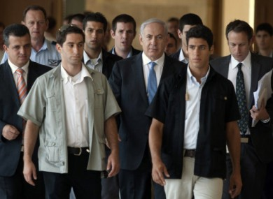 Israeli Prime Minister Benhamin Netanyahu, centre, photographed yesterday with his bodyguards.