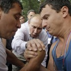 No pressure... Putin judges an arm wrestling match during a visits in the Seliger youth educational forum about 450 km northwest of Moscow earlier this month. (AP Photo/Mikhail Metzel,Pool)