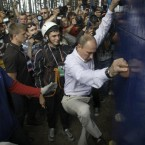 The Russian prime minister attempts a climbing wall. (AP Photo/Mikhail Metzel, Pool)