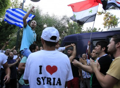 Syrians living in Greece protest outside the Syrian embassy in Athens on Tuesday.