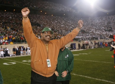 Smith celebrating in 2006, as his jersey is retired by Michigan State..