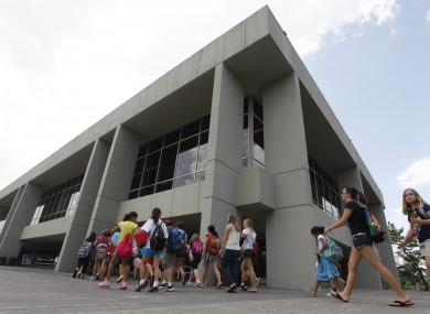 Virginia Tech campers walk into Dietrick Hall after a lockdown of the campus was lifted at the school.