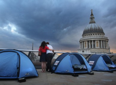 Campers prepare to spend the night on top of a London skyscraper in aid of charity