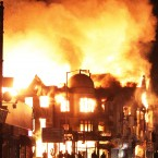 A store on fire near Reeves Corner, Croydon, south London on the third night of rioting (Lewis Whyld/PA Wire)