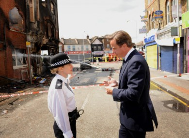 Prime Minister David Cameron talks to Acting Borough Commander Superintendent Jo Oakley in Croydon, south London, yesterday.