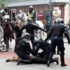 Police restrain a man in Manchester after trouble in the city centre.