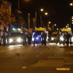 A view of riot police in Toxteth, Liverpool, as around 200 missile-throwing youths gathered in the south Liverpool causing disorder and damage.