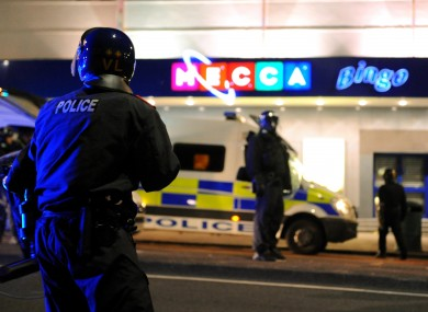 Riot police outside a bingo hall in Eltham, south London