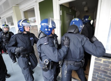 Metropolitan Police officers carry out a raid on a property on the Churchill Gardens estate in Pimlico during Operation Woodstock, London.