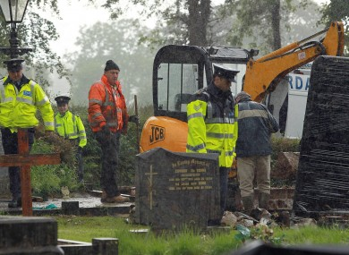 The remains of a body, thought to have been that of Columba McVeigh, are removed from a graveyard in Scotstown in June. The remains have been shown not to belong to McVeigh.
