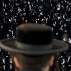 Ultra-Orthodox Jews attend a prayer in the religious neighborhood of Mea Shearim, Jerusalem (AP Photo/Bernat Armangue)